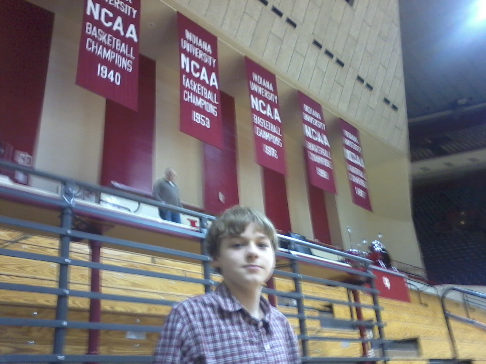 Aiden and the 5 National Championship banners hanging at Indiana University